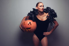 Model holding halloweens pumpkin Stock Photography