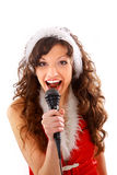 Model holding karaoke and wearing christmas hat Royalty Free Stock Images