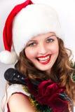 Model holding karaoke and wearing christmas hat Stock Image