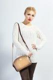 Model holding little purse Stock Image