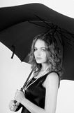 Model holding umbrella Stock Images