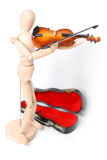 Model holding violin with case. Standing. Model is made of wood and is often used for drawing art. Model can represent any ethnicity or gender Royalty Free Stock Image