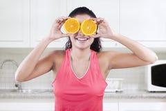 Model holds two piece of orange Stock Photos