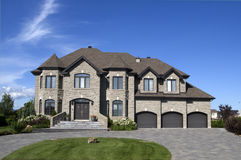 Model home 1. High end 3 car garage model home in suburbia Stock Photography