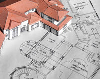 Model home and blueprints Royalty Free Stock Image