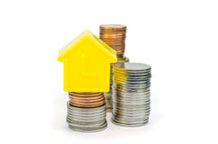 A model home and coins Royalty Free Stock Images
