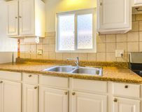 Model home kitchen in southern California with view of the kitch Royalty Free Stock Photography