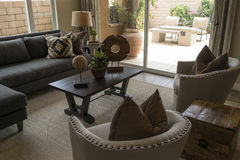 Model home living room and patio. Model home furnished living room and patio Stock Image
