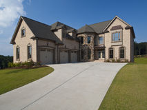 Model home luxury house with driveway Stock Photos