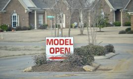Model Home Open. A Reality Agency Real Estate Agent is having an open house to showcase its brand new model homes that have been constructed in an upscale area Royalty Free Stock Images