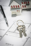 Model Home, Pencil and Keys Resting On House Plans Royalty Free Stock Images