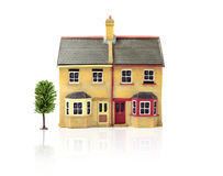 Model House. Studio image of modest 'first-time buyer' dwellings with white space and soft reflections. Copy space. Ideal for real estate or mortgage concepts stock photography