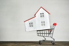 Free Model House And Shopping Cart. Buying Home Concept. Mortgage Rent Stock Images - 171011524