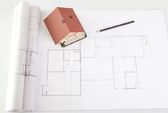 Model house on architecture construction plan Royalty Free Stock Image