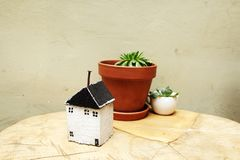 Model of house as symbol. On wall background Stock Photography