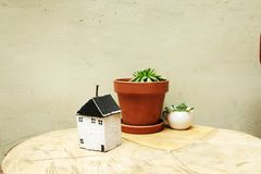 Model of house as symbol. On wall background Stock Image