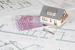 Model house on blueprint background royalty free stock photo