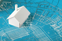 Model house on blueprints Stock Photo