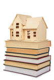 Model of house on books. On a white Stock Photo
