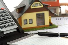 Model house and calculator Stock Photo