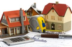 Model house and calculator Stock Images
