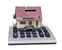 Model house and calculator Stock Photos