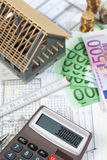 Model house calculator euro notes on blueprint, planning constru Royalty Free Stock Photo