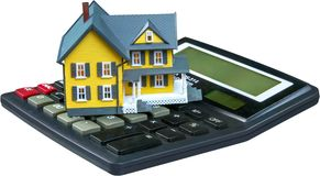 Model of a House on Calculator - Isolated. Real estate loan calculator currency credit house prices house lease Stock Photography