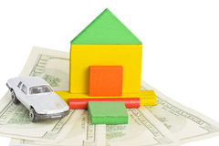 Model of house and car standing on money Stock Images