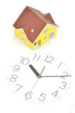 Model house and clock face Royalty Free Stock Images