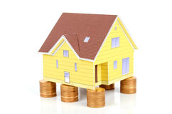 Model house and coin Stock Photo