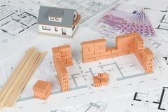 Model house construction with brick on blueprint stock photography