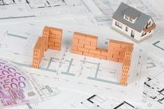 Model house construction with brick on blueprint stock photos