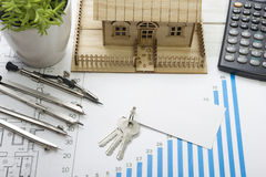 Model house, construction plan for house building, keys, blank business card, divider compass. calculator. Real Estate Royalty Free Stock Photography