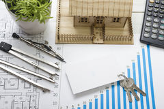 Model house, construction plan for house building, keys, blank business card, divider compass. calculator. Real Estate Royalty Free Stock Photos