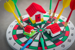 Model house on dartboard Royalty Free Stock Photos