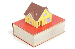 Model house and dictionary Royalty Free Stock Image