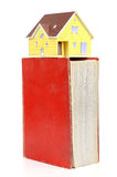 Model house and dictionary Royalty Free Stock Photos