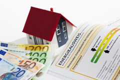 Model house with energy performance certificate and bunch of euro notes Royalty Free Stock Photography