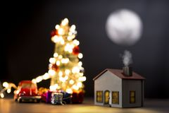 Model house with full moon at night royalty free stock image