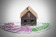 Model house on fanned euro notes. Cost of home building Stock Images