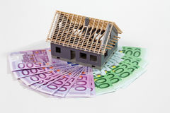 Model house on fanned euro notes. On white background Stock Photo