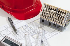 Model house folding ruler calculator hard hat pen on blueprint Royalty Free Stock Photography