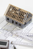 Model house folding ruler calculator hard hat pen on blueprint Stock Images
