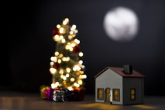 Model house with full moon at night stock images