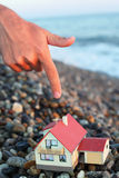 Model of house with garage on beach in evening Royalty Free Stock Photography