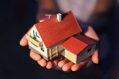 Model of house with garage on hands Royalty Free Stock Photography