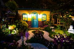 Model House with a garden full of flowers Royalty Free Stock Images