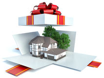 Model of a house in gift box with red ribbon Royalty Free Stock Photo