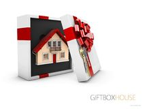 Model of a house in gift box with red ribbon, 3d illustration.  Stock Images